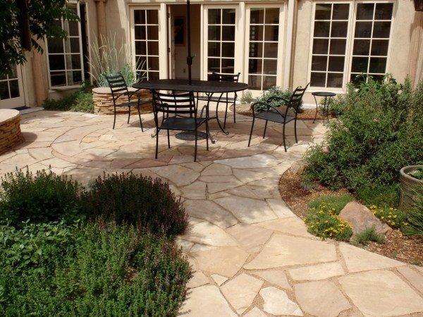 modern-patio-design-stone-pavers-wrought-iron-garden-furniture.jpg