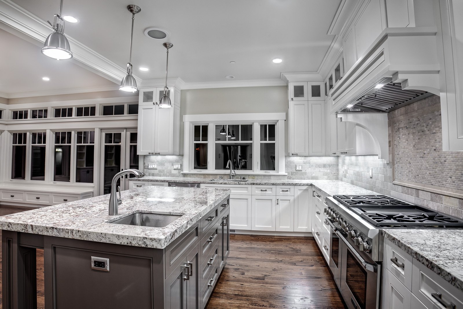 wonderful-kashmir-white-granite-countertops-for-contemporary-kitchen-ideas-together-with-metal-pendant-lamps-and-wooden-floor.jpg